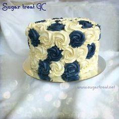 Simple wedding cake. 8 inches round x 6 inches tall. Vanilla cake with vanilla buttercream swirls, white and navy. Sugar Treat Home Baking