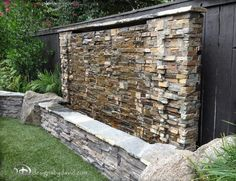 A backyard would contain a waterfall