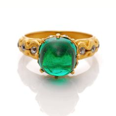 Exceptional Marcus & Co. Colombian Emerald Gold Ring. Simply Breathtaking Colombian emerald gold ring attributed to a linage American jeweler Marcus & Co.. This 1900s treasure centers on a bright and glowing translucent green cabochon emerald, weighing approximately 4.3 ct, which makes this precious ring exceptional. The beautifully textured Art Nouveau style mount showcases the height of the American Art Nouveau style which distinguishes the renowned jeweler. c 1900
