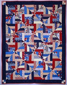 Strip Twist Quilt of Valor by Paula, the quilter. This quilt started with a Moda Jelly Roll in red, white, and blue. The pattern, Strip Twist, is from Bonnie Hunter's Quiltville.