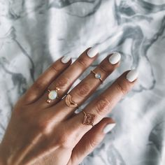 Layered rose gold rings and opal .