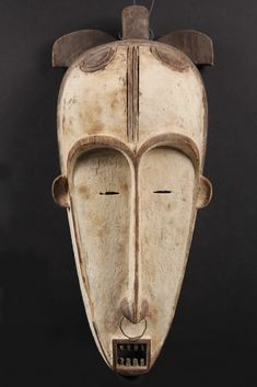 AFRICAN MASK - Fang People, Gabon, Ngil ancestral spirit mask, used in judicial proceedings, carved wood with kaolin, wire nose ring, 20th c...