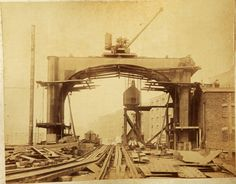 Photos of the construction of London's Tower Bridge - found in a skip, and then kept in a bag under a bed for 5 years!