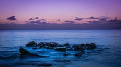 The colors are stunning in this beautiful oceanscape by photographer Carrie Cole.