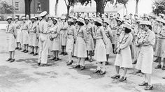World War II. Women's Army Auxiliary Corps was established in 1941, prior to U.S. entry into World War 2. The Third Platoon, Company 1, Fort Des Moines, Iowa, of African American women stands at ease with their commander, Captain Frank Stillman.