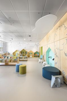 Children's reading area at Aldinga Library, SA. Designed by Brown Falconer Architects, photography by David Sievers Like the feel of this room. Perhaps a bit too young overall. Clouds on the ceiling - acoustic material to damp sound? Daycare Design, Classroom Design, School Design, Kindergarten Interior, Kindergarten Design, Micro Creche, Kids Cafe, Kids Library, Learning Spaces