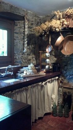 Colonial kitchen, like the curtains instead of cupboards only use heavy linen or burlap