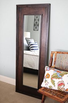 Upcycle that old $5 mirror into an amazing DIY statement piece. You just need a full-length mirror, some wood, stain, tools, and Elmers ProBond Advanced to achieve this chic leaning floor mirror. homedecor - http://www.homedecoras.net/upcycle-that-old-5-mirror-into-an-amazing-diy-statement-piece-you-just-need-a-full-length-mirror-some-wood-stain-tools-and-elmers-probond-advanced-to-achieve-this-chic-leaning-floor-mirror-home