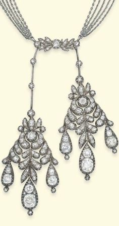 AN ANTIQUE DIAMOND LAVALIERE  Designed as a pair of twin girandole pendants of foliate motif, each mounted with old-cut diamonds and suspending three pear-shaped drops, to the knife-edged bar connections accented by diamond collets with diamond-set surmount of similar motif, the necklace comprised of five box-link chains interspersed with rose-cut diamond bar spacers to the sapphire and diamond-set navette-shaped clasp, converted from a pair of early 19th century ear pendants, circa 1820
