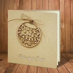 """The Christmas card is made of high quality eco beige paper. The eco beige cover has a laser cut application - Christmas decoration and it has inscription laser cut """"Merry Christmas"""". The application is attached with a cord to the cover.The insert is ecru mat. The envelope is included."""