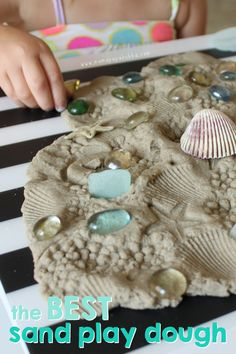 Sand play dough paired with loose parts.