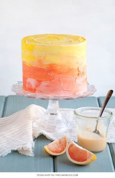 Pink Grapefruit Cake. A light olive oil cake filled with grapefruit curd and frosted with whipped vanilla buttercream - perfect for spring brunches, showers and birthdays   by Tessa Huff for TheCakeBlog.com