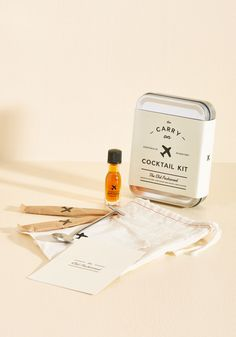 <p>Make your window seat feel like a swanky lounge at 30,000 feet by shaking things up with this carry-on cocktail kit! Complete with bitters, two packets of cane sugar, a metal bar spoon, and a linen coaster to keep things classy, this Old Fashioned set makes toasting your travel savvy a breeze!</p>