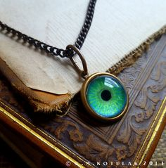 Iris Charm  Emerald / Medium  Brass Eye Pendant by Hibernacula, $18.00