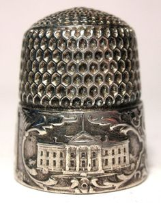 This thimble was made by Simons Bros. of Philadelphia, circa 1893. It portrays the Capitol and the White House, each encircled by scrolls, and divided by the vertical line of the Washington Monument. Sold on e-Bay 6/2016 for $177.50.