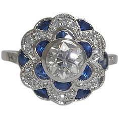 2.14 Carat Diamond Sapphire Platinum Flower Ring  | From a unique collection of vintage engagement rings at https://www.1stdibs.com/jewelry/rings/engagement-rings/