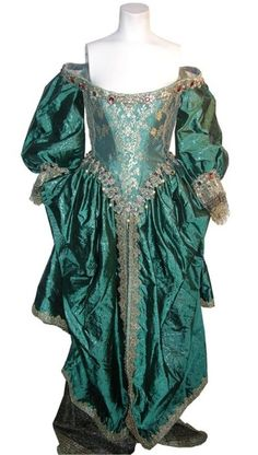 """Milla Jovovich """"Milady de Winter"""" green brocade gown from The Three Musketeers. Costume designed by Pierre Yves Gayraud"""
