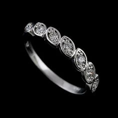Diamond Prong Set Half Way Modern 14K White Gold Wedding Band. $419.00, via Etsy.