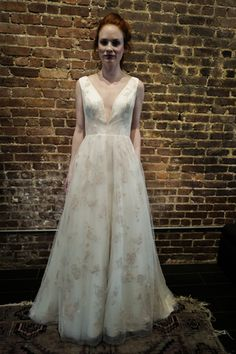 Romantic flowy sheath wedding dress with plunging v-neckline + floral pattern from Ivy and Aster Spring 2017 collection {Dan Lecca}