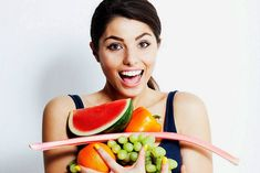 Woman is holding vitamins and vegetables!