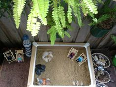 A carton box filled with sand for a beach provocation - at Puzzles Family Day Care ≈≈