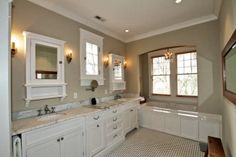 Master bath example of tub in arched nook;  also like the built-in towel rack to left of vanity at front of pic.