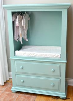 DIY TV Wardrobe Makeover. A great way to get a customized change table for the cost of some paint and an old TV armoire.