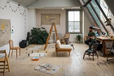 This Stunning Studio in Rhode Island Is a Creative's Dream - Photo 5 of 10 - With plenty of space, Spellman is able to utilize his studio to create his artwork and music, as well as use the area as a gathering area for entertainment.