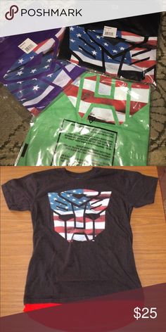 Retro Transformer Extended T-shirt Brand new in original packaging! Rare Transformers Extended T! Fashionable and fun! Purple size Large. GReen size Medium. Black size Small with WHITE extension not red. I'm not sure the other color extension probably white or black! Don't want to damage the pristine packaging! Enjoy! Adidas for views Urban Outfitters Shirts Tees - Short Sleeve