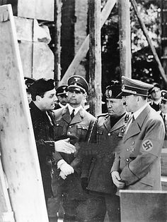 """Hess, Mussolini and Hitler in 1938. This is a rare occasion when Hitler actually is shown listening to someone else. He was a notorious talker and even Magda Goebbels complained in the late 30′s that he just talked on an on and """"bored his..."""