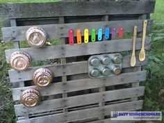 Creating an Outdoor Learning Space-- made it by screwing various metal objects to a wood pallet ($0 from a scrap pile). We again used the old pieces that were rescued from the broken xylophone. We also used some jello molds (4 for $0.50 each at Goodwill), and an old muffin tin ($0 had on hand already, originally purchased from Dollar Tree for $1). We used a couple teacup hooks to hold up two wooden spoons ($0 had on hand) for the children to make music with.