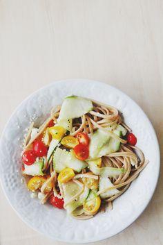 Whole weat linguine, zuccini, garden tomatoes, feta, olive oil, salt, and pepper.