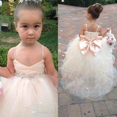 Vestidos de desfile para niñas Spaghetti vestidos de niña sin mangas de flores Vestidos de boda de marfil blanco Champán Vestidos de novia Vestido de novia Cinturón