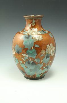 Oh how I love anything orange. Spectacular Cloisonne vase with mint and orange.