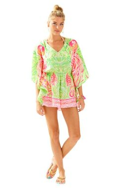 The Mai Romper is a soft, engineered printed romper. This V-neck romper has full kimono sleeves and makes the ultimate Spring Break vacation outfit.