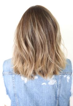 Natural color, blonde highlights. Medium length.