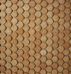 Versacork penny tiles - grout color matches the color of the concrete floor in the rest of the house.  I grew up with tiled cork floors and they were  AMAZING!!!!!  Easy care, easy on the feet but these days a little more pricey!