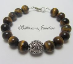 Gorgeous Stackable Bracelet Expertly Crafted with Natural Tigers Eye Beads by Bellissima Jewelers, $79.00