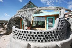 Earthship Homes - Eco-Friendly Use of Tires and Dirt, really want to build my home like this self sustaining