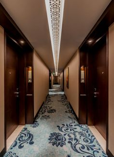 Image from Kempinski Hotel Shahdara by Illuminate Lighting Design Hotel Hallway, Hotel Corridor, Kempinski Hotel, Flur Design, Centre Commercial, Hotel Reception, Lobby Interior, Lux Hotels, Hallway Designs