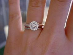 1.5 carat round solitaire with 6 white gold prongs and a matching wedding band. Perfection. :)