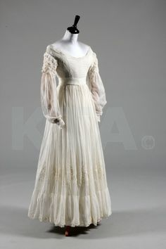 A whitework embroidered gown, 1830s, with horizontal gathers, whitework bands to the bodice
