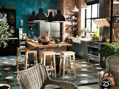 ikea kitchen: stainless steel cabinets, wood counter tops, and brick walls.
