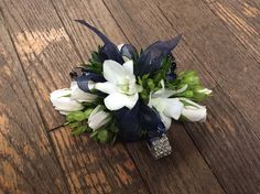 Navy blue and white prom corsage with roses and dendrobium orchids ~Terri's Flower Shop~ By:Samantha Miles