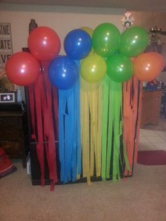 RAINBOW PARTY cover big screen with this diy rainbow #streamers #balloon #rainbow #big screen #kid party #rainbow party BY CHRISTINE LOLLAR
