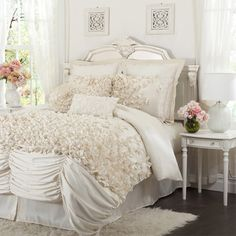Four-piece faux silk comforter set with handmade bows.         Product: Queen: Comforter, bedskirt and 2 standard shams