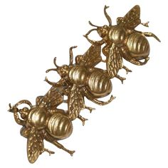The bee pin is signed Joseff Hollywood. The three Russian gold tone bees are attached to a bar and they seem to be floating. The bodies of the bees