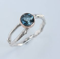 I've just found Handmade Blue Topaz Twig Ring November Birthstone. This November birthstone ring is Inspired by nature and handmade in silver and rose gold and set with a sparkling london blue topaz.. £195.00