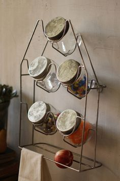 """Serious kid-in-a-candy-store stuff. Glass canisters to better see what's inside and a handy metal wall rack to keep them organized. brbrliDimensions: 13""""w x 5""""d x 19""""h (Jars) 3.5""""d x 4""""hlibr..."""