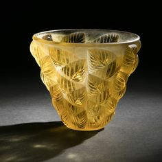René Lalique (1860-1945)  Moissac, also said leaves embossed pattern created March 14, 1927  Vase press-molded glass yellow and partly satin. Small chips at the base. (Ref. 992 Marcilhac page 437). Signed R. Lalique France at the wheel in intaglio under the base. D. 13 cm